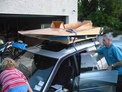 Strapped to the roof, that's Garth who helped me lift it on, and Arlo climbing on the bonnet.