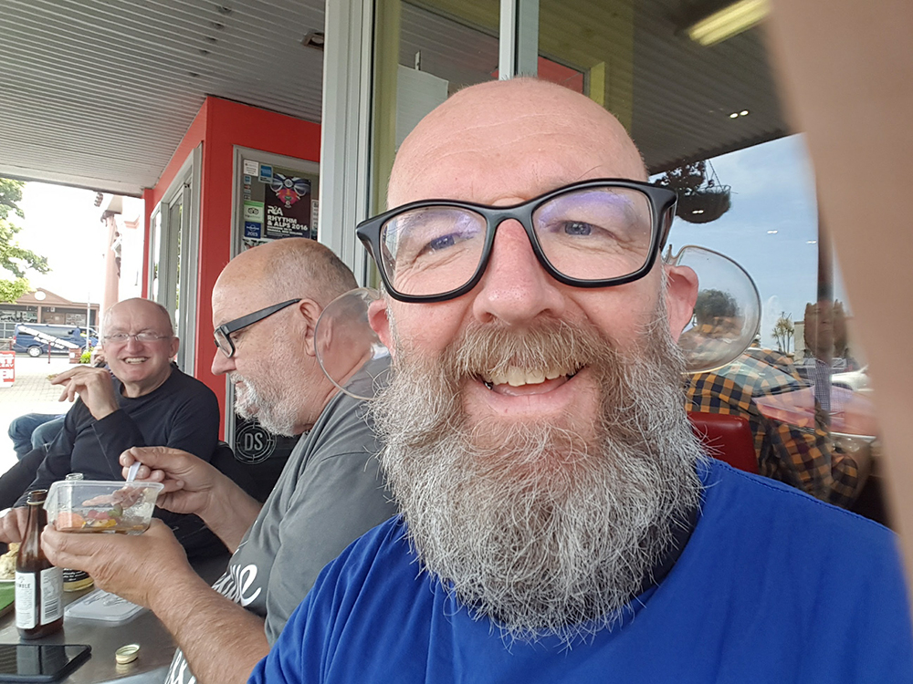 I try on Bill's ear glasses.